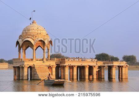 Jaisalmer, India - February 15: An Unidentified Man Rows Boat Near Gadi Sagar Temple On February 15,