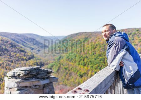 Back Of Young Man In Blue Jacket Looking At Canaan Valley Mountains In Blackwater Falls State Park I