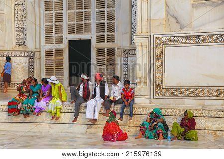 Agra, India - November 9: Unidentified People Sit Outside Taj Mahal On November 9, 2014 In Agra, Ind