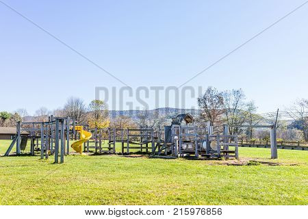 Wooden Children's Playground Empty In Countryside By School With Slide In Mountain Countryside, Rura