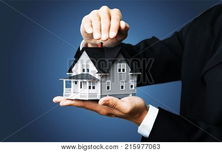 Holding model male hands house hold white