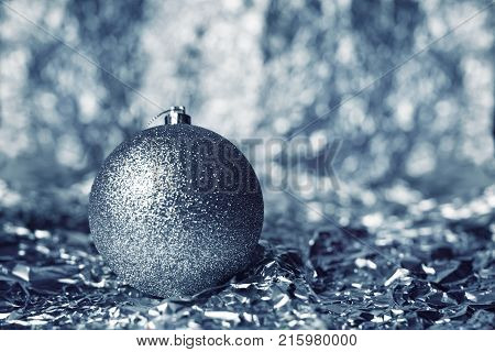 Silvery Christmas Ball On A Silvery Background