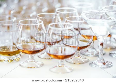 Whiskey Bourbon In A Glass With Ice On Wooden Table White Background