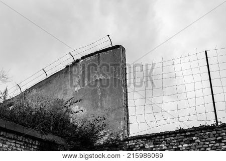 A barbwired wall of the fortress that became the Terezin concentration camp in the Czech Republic - Black and White