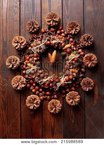 Christmas Closck Made Of Wreath Of Acorns And Cones And Dog Rose On The Wooden Background.ceative Cl