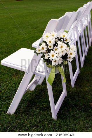 Single Row Of Guest Chairs For Outdoor Wedding