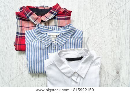 Three Shirts White, Checkered, Striped. Collage. Fashionable Concept.
