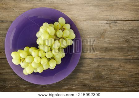Grapes On A Wooden Background. Grapes On A Plate