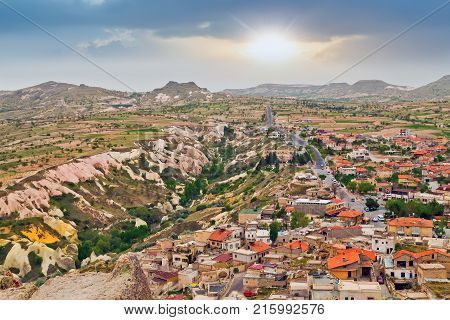 The Town Göreme With Rock Houses In Front Of The Spectacularly Coloured Valleys Nearby
