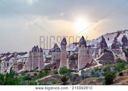 Rising Sun Love Valley Volcanic Mountain Landscape In Cappadocia, Turkey