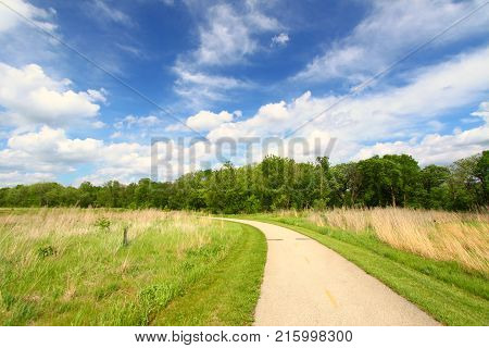 Recreation Path through the prairie at Blackhawk Springs Forest Preserve in Illinois.
