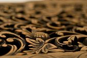 Wood carving of rose motif with deep depth of field poster