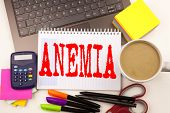 Word writing Anemia in the office with surroundings such as laptop marker pen stationery coffee. Business concept for Medical Diagnosis Iron deficiency aplastic Workshop white background with space poster