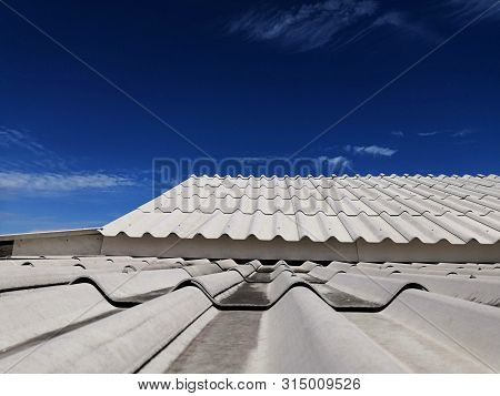 Double Roofing Tiles And Slope With Clouds And Blue Sky Background.tile Roof With Blue Sky.