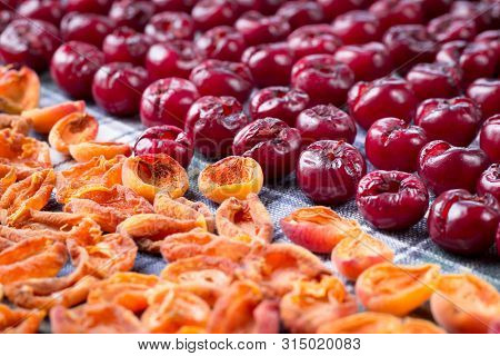 Background pattern of fresh mellow cherry berries prepared for cooking and sun drying for conservation poster