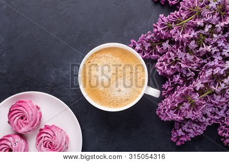 Lilac, Cup Of Coffee, Homemade Pink Marshmallow On Black Stone Background Top View