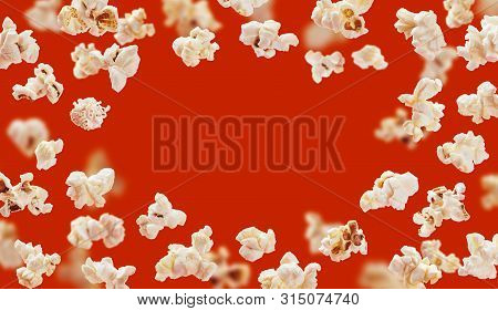 Popcorn Frame, Flying Popcorn Isolated On Red Background With Copy Space, Movie Poster Concept