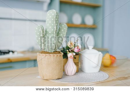 Decorative Soft Cactus In A Pot. Pink Vase With Flowers And A White Kettle In The Decor Of The Kitch