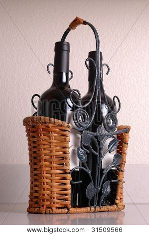 Red wine bottles in basket