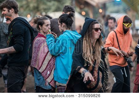 Riomalo De Abajo, Extremadura, Spain - July 15, 2018: A Couple Share A Pacifier At The Lost Theory P