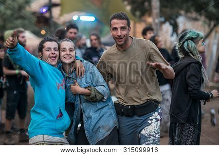 Riomalo De Abajo, Extremadura, Spain - July 15, 2018: A Couple And A Man Looking To The Camera In Th