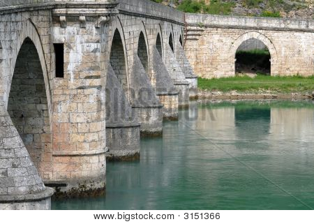 Close-up image of old stone middle age bridge pillars Visegrad Serbia poster