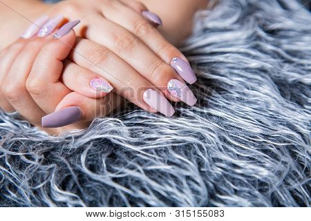 Perfect Manicure with Trendy Purple Nail Art on Fake Gray Fur Pelt poster