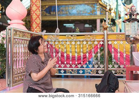 Bangkok, Thailand - March 11, 2019 : Unidentified Thai Buddhism People In Buddhist Pray For Benefact