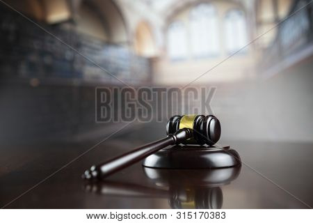 Law, Auction And Business Concept.  Gavel In The Lawyer Library.