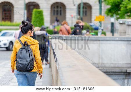 Prague, Czech Republic - May 9, 2019: Young Millennial Woman Exploring Prague As Travel Destination