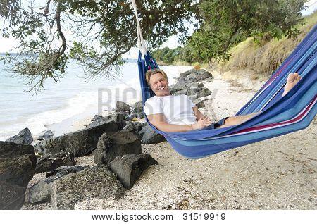 happy smiling man in hammock