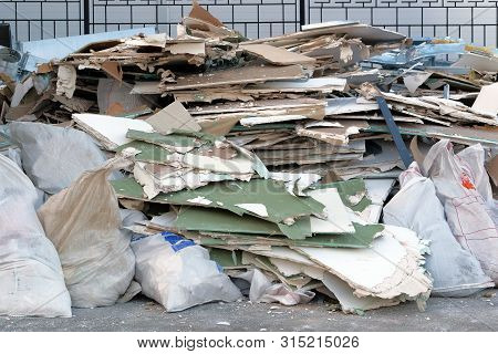 Garbage Pile, Ecology Contamination With Plastic And Construction Garbage. Removal Of Debris. Trash