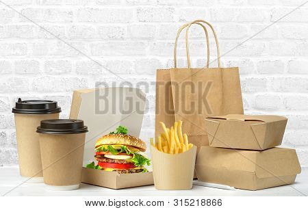 Fast Food Big Lunch Set Of Tasty Hamburger, French Fries, Paper Coffee Cups, Brown Paper Bag And Box