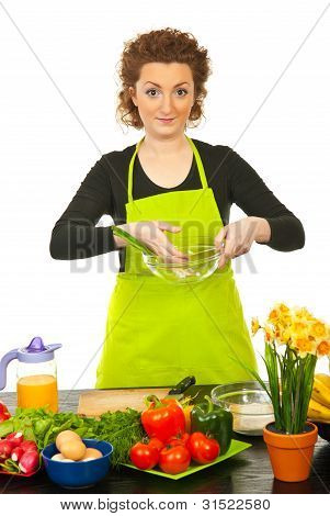 Redhead Woman Put Green Onion In Bowl