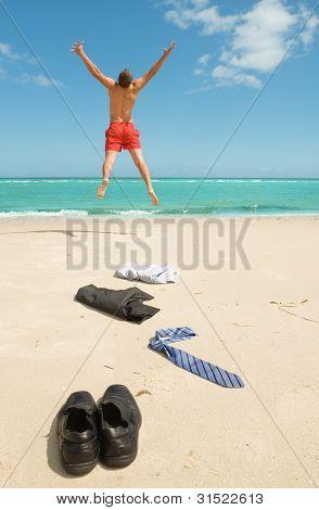 Businessman Jumping On The Beach