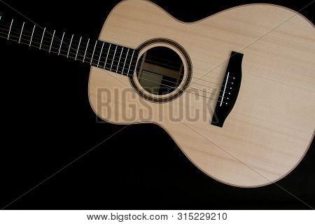 Acoustic Guitar Music Close-up Flat-lay Image On Black Background. Singer Songwriter Folk Guitarist