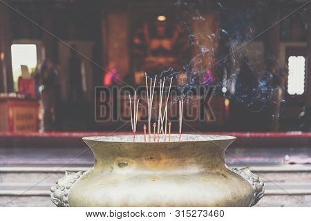Joss Stick Or Incense Sticks Burning By Fire With Smoke For Buddhist Pray For Benefaction Worship To