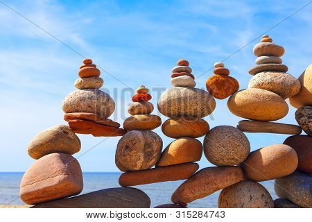 Lots Of Balanced, Colorful Stones On A Beach On The Background Of The Sea. Concept Of Life Balance,