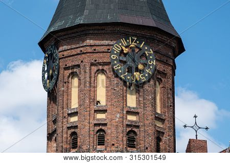 Clock Tower Of Konigsberg Cathedral. Brick Gothic-style Monument In Kaliningrad, Russia. Immanuel Ka