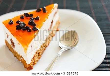 Orange Jelly Cake With Mousse And Cranberries On Top.