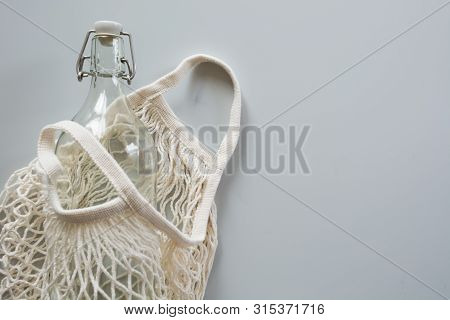 Eco Natural Textile Mesh Bag With Metal And Glass Bottle For Reuse.sustainable Lifestyle Concept. Ze