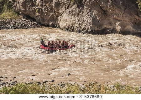 Rafting In A Torrent Created By The Melting Waters Of The Andean Snows