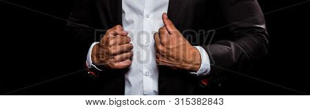 Panoramic Shot Of Bi-racial Man Touching Suit Isolated On Black