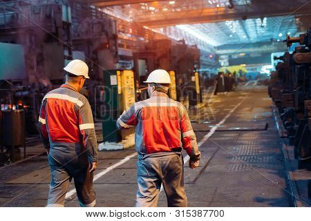 Workers In The Steel Mill. Metallurgical Industry.