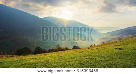 Amazing Beautiful Rural Area At Sunrise. Morning In The Carpathian Mountains. Fog In The Distant Val