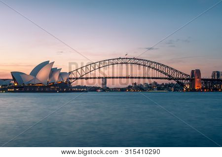 Sydney, Australia - November 7, 2014: Sydney Iconic Landmarks Of Sydney Opera House And Sydney Harbo