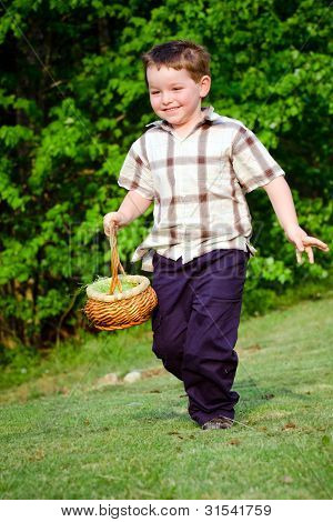 Boy running with easter basket