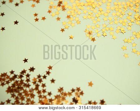Golden Stars Glitter On Blue Background. Festive Holiday Bright Backdrop