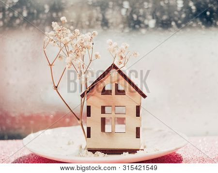 Wooden House Model With A Tree