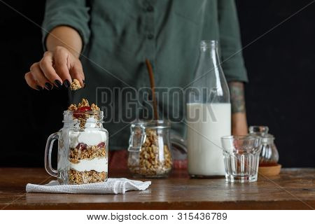 The Glass Of Granola With Dried Berries And Yogurt.